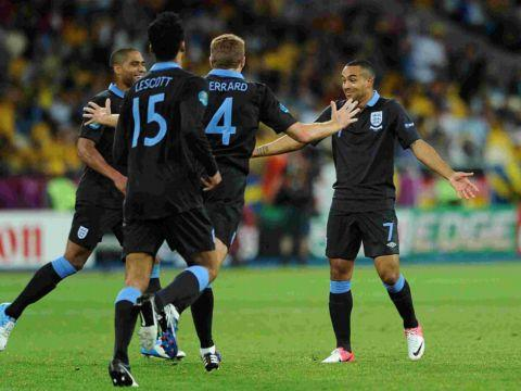 Walcott is congratulated after scoring in the 3-2 win against Sweden