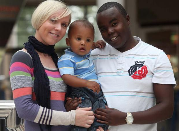 Winner of Child of the Year 2011 Toro Henguva with his parents Aga and Walter.