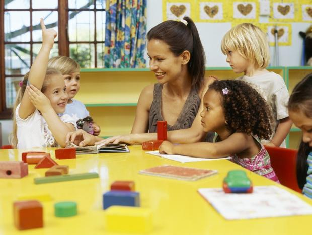 Stock image of a woman looking after children