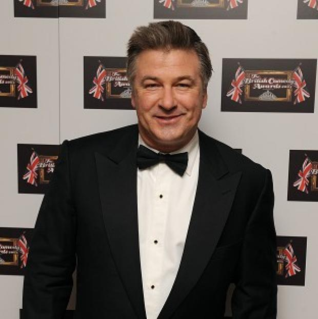 Alec Baldwin has denied accusations he punched a photographer