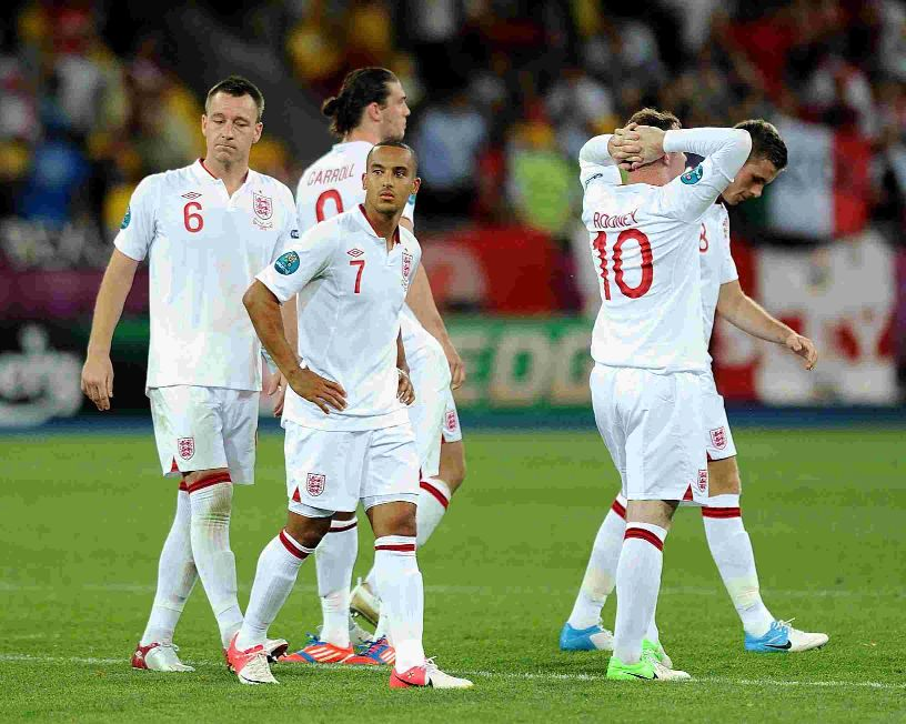 Theo Walcott, centre, and other England players cant hide their dismay after the penalty shootout