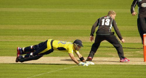 Daily Echo: A bat-less Glenn Maxwell dives for the crease during Hampshire's win against Surrey (Pic: Neil Marshall)