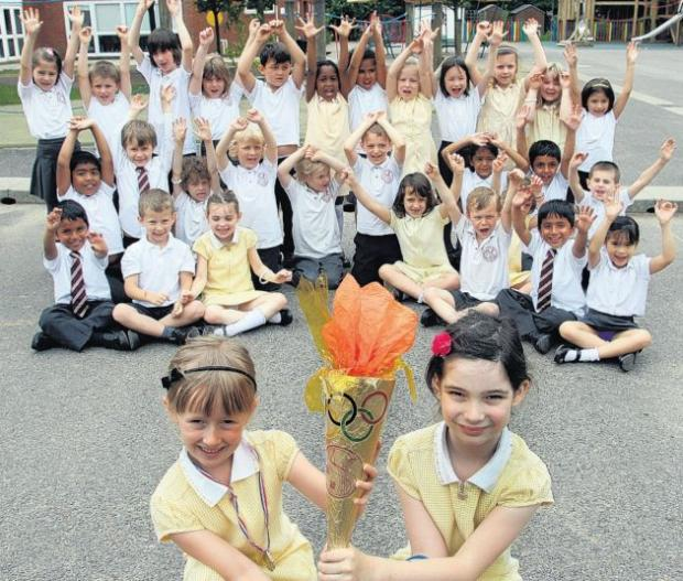 Springhill Catholic Primary School pupils with their own version of the Olympic torch.