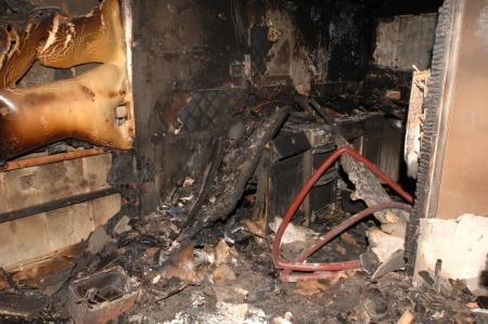 The kitchen of flat 72, with the remains of a cooker and scorched units, where the temperature reached up to 1000 degrees centigrade.