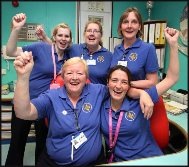 Daily Echo: Nursing staff celebrate after the cardiac unit is saved