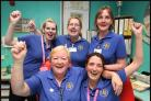 Nursing staff celebrate after the cardiac unit is saved