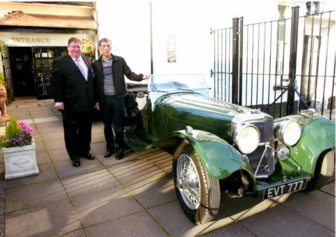 The Prince admires a 1937 Jaguar SS100 sports car with Jerry Mahony