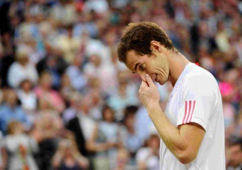 Murray tries to stop the tears from flowing after his defeat.