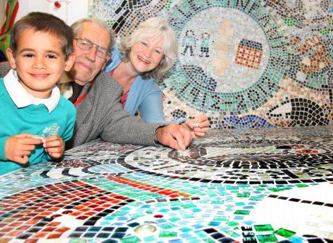 Four-year-old Yashan Robinson with 96-year-old Edward Scammell and mural creator Hilary Moore.