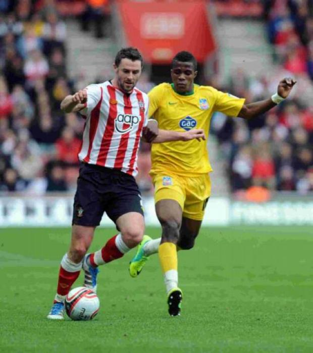 Wilfried Zaha, right, battles with Saints' Frazer Richardson last season