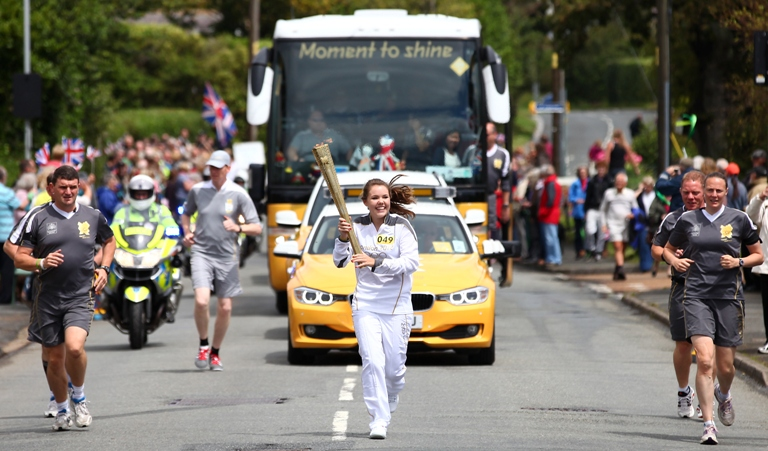 Hattie Gould, from Whiteley, carries Olympic torch on the Isle of Wight