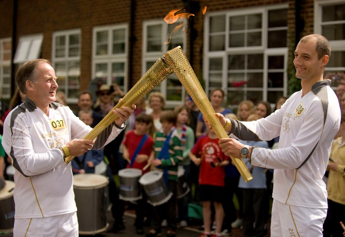 Torch bearers Steve Barker and Ben Pugh at Brockenhurst College