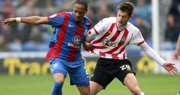 Nathaniel Clyne and Adam Lallana battle it out
