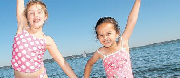 Bronte Lowry and Paris Wateridge show how happy they are at Lepe Beach.