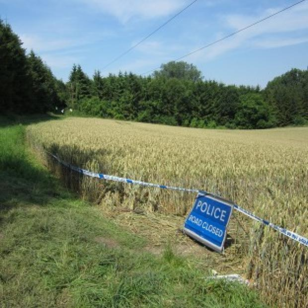 The scene at the footpath near Newport, Essex, where a jogger was killed after an electricity cable came down in a field (PA)