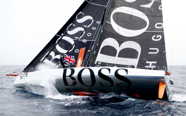 Alex Thomson celebrates beating the record for sailing solo across the Atlantic. Photo: Christophe Launay
