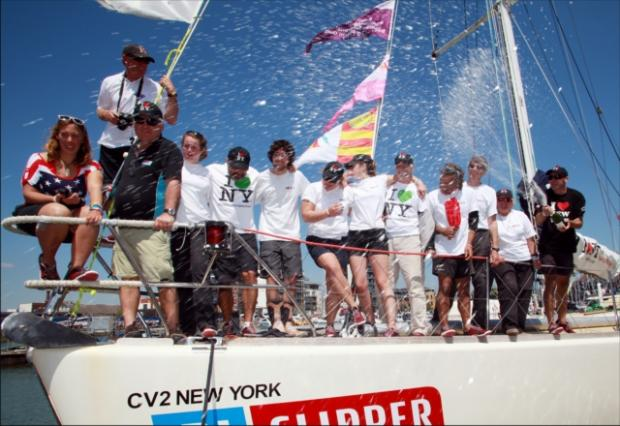 HAPPY RETURN: Gareth Glover of Southampton, skipper of the clipper New York, sprays his crew with champagne on their return to the city.