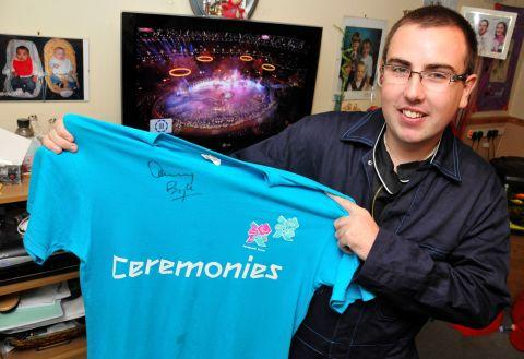 Thomas Wearne with a shirt signed by Danny Boyle