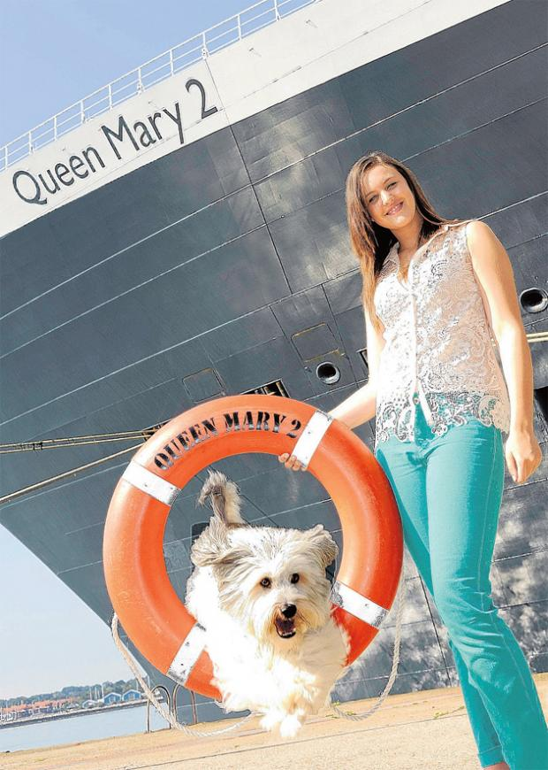 Ashley Butler with her dog Pudsey after their trip on the QM2.