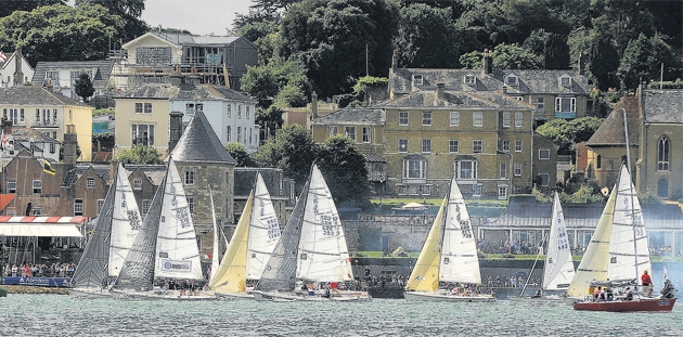 The J80 class race in front of the Royal Yacht Squadron during day four of