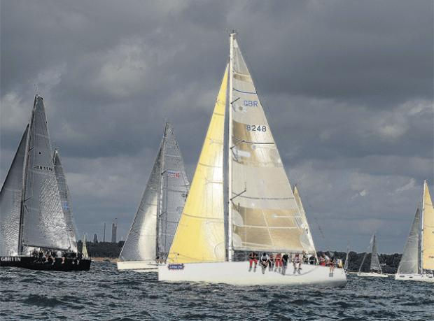 Racing action in The Class 1 IRC takes place under black storm clouds. Photo by Alan Crowhurst/Getty Images