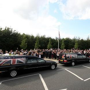Daily Echo: Friends and family lay flowers on the hearses of three servicemen killed in Afghanistan