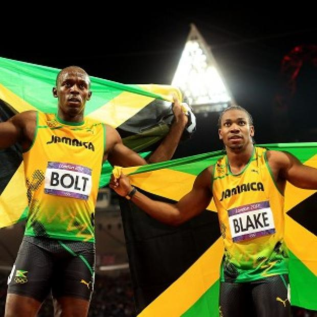 Yohan Blake, right, broke his personal best in the 100m to steal Usain Bolt's limelight