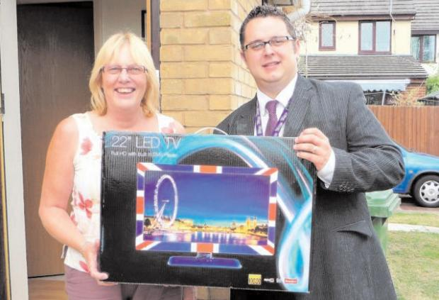 Darryl Harding is presented with a brand new TV by Cllr Thorpe