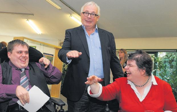 Christopher Biggins with Shaun Barker and Lizzie Angus-Smith practising the Queen's wave at the launch of the Enham Resource Centre Campaign.