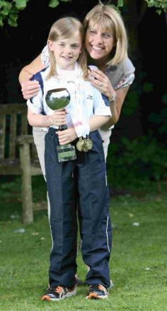 Nine-year-old Elspeth, pictured with mum Jackie, won a host of gold medals at the British Transplant Games