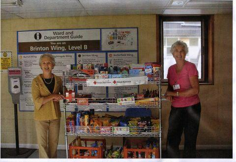 (L-r) Volunteers Jean Lee and Pat Cooke with their trolley shop