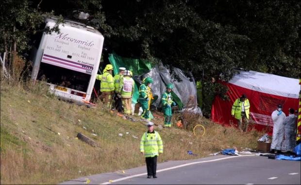 Daily Echo: Emergency services at the scene of a coach crash on the A3 near Hindhead in Surrey