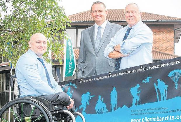 Pictured, from left, are injured serviceman James Wilson, Rob Allen of Persimmon Homes and Mike Kitt, founder of Pilgrim Bandits.