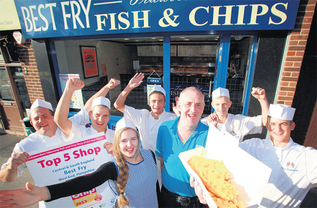 Best Fry Fish and Chips staff celebrate winning a quality award. Owner John Lee is pictured with Scott Turner, Charlotte Lee, Nick Beattie, customer Steve White, Tom Coxhead and Nathan Digwood