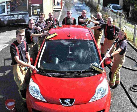 Firefighters wash cars for charity