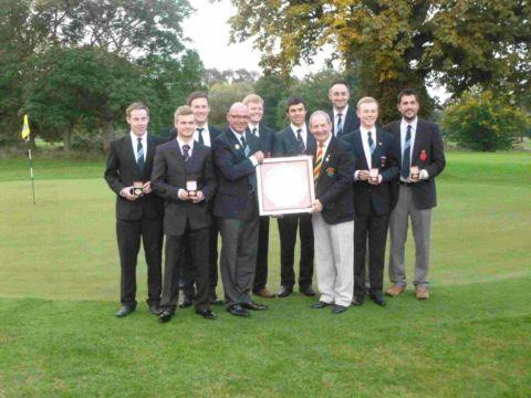 Hampshire's Richard Elmes, fourth left, is presented with the England Golf South Eastern Group winners' salver