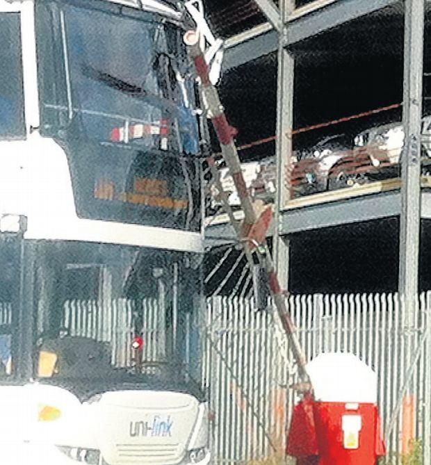 The bus caught in the crossing barrier