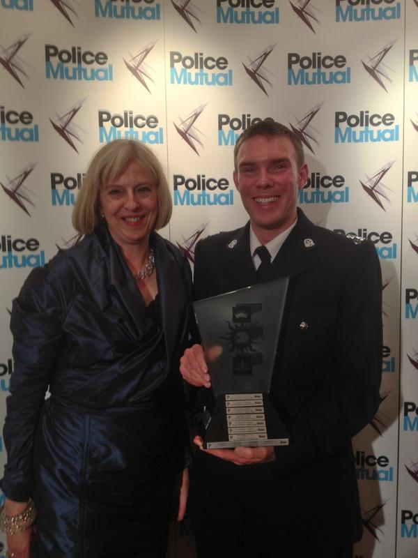 PC Alex Stypulkowski with Home Secretary Theresa May at the Police Bravery Awards.