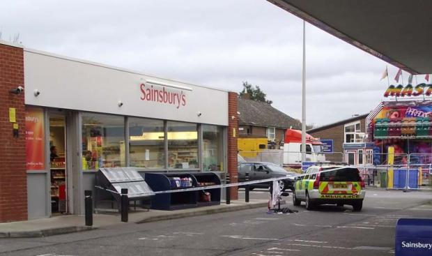 Police tape off area outside Sainsbury's petrol station. Photo by Danielle Bottell