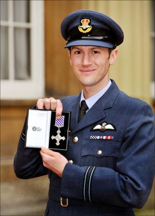 Hero pilot's bravery award after daring rescue of 30 troops