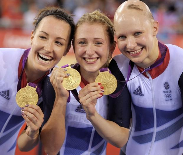 Dani King, left, celebrating with the women's pursuit team