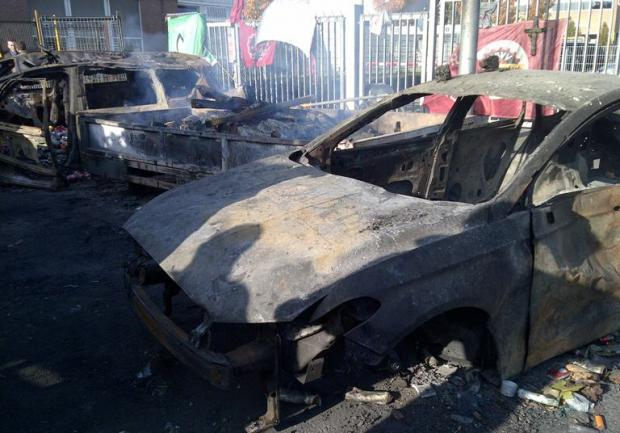 Daily Echo: Burned out cars outside the Ford Genk plant
