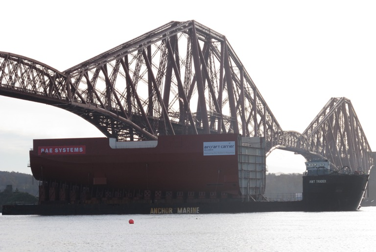 The 11,300t section of HMS Queen Elizabeth passing under the Forth Bridge as it nears the end of the journey to Fife