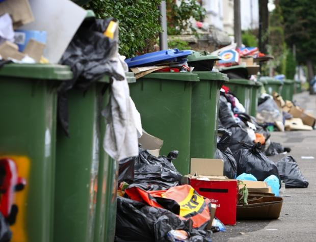 Strikes by binmen last year over cuts brough rubbish to city streets