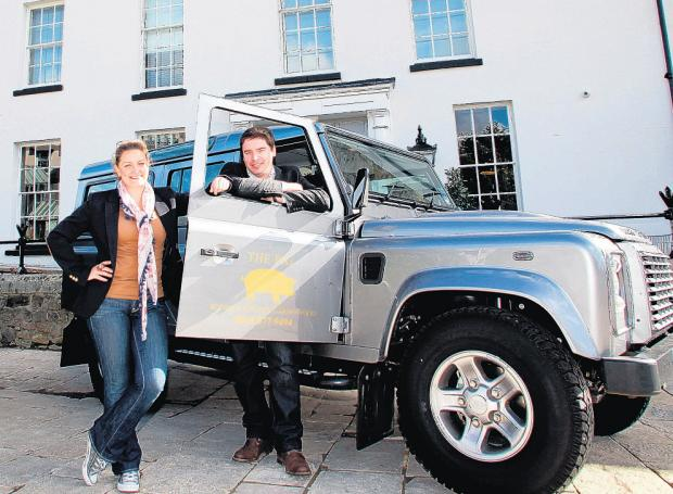 Hotel Directors Lora Strizic and Jorge Gertrudes with The Pig Land Rovers, outside The Pig in the Wall