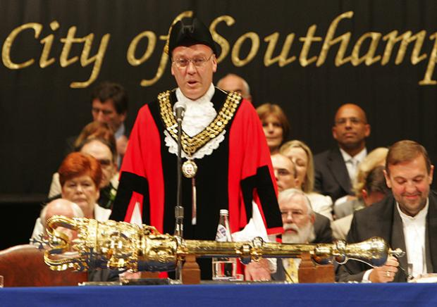 The former mayor Stephen Barnes-Andrews with the mace.