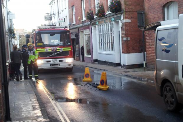 Road cracks open in town centre