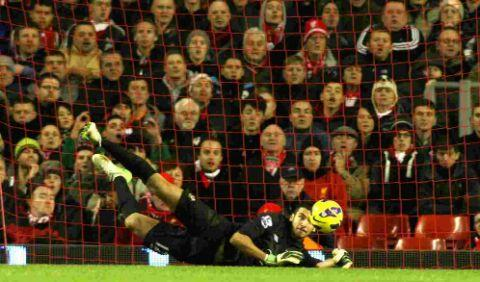 Paulo Gazzaniga makes  a save at Anfield.