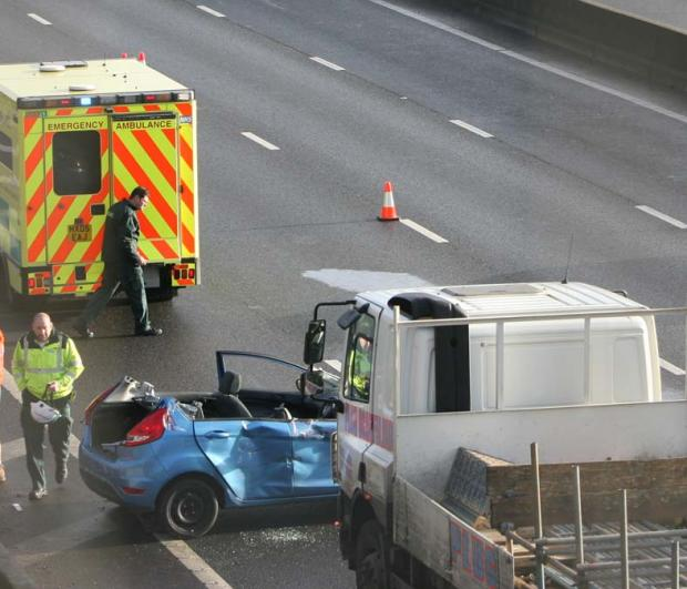 Woman cut free from car after motorway crash