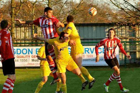 Lewis Fennemore, right, about to give Sholing the lead.